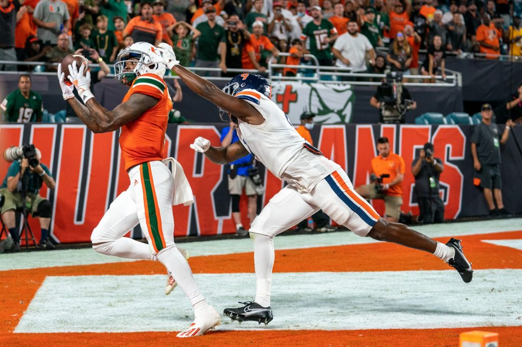 Senior wide receiver Mike Harley catches a pass for a touchdown during the third quarter of Miami's game versus the University of Virginia at Hard Rock Stadium on Sept. 30, 2021. Harley had six receptions for 45 yards, and one touchdown.