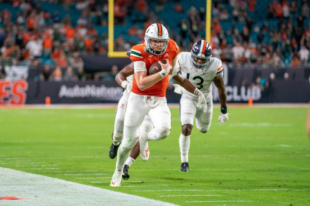 Freshman quarterback Tyler Van Dyke rushes towards the end zone during the third quarter of Miami's game versus the University of Virginia at Hard Rock Stadium on Sept. 30, 2021. Van Dyke rushed for 24 yards, scoring a touchdown on the play.