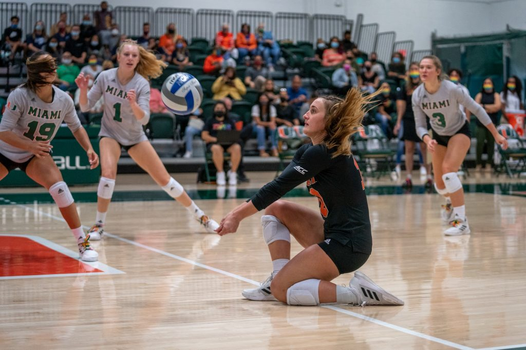 Senior defensive specialist Priscilla Hernandez kneels to bump the ball during the first set of Miami's match versus the University of North Carolina in the Knight Sports Complex on Oct. 1, 2021.