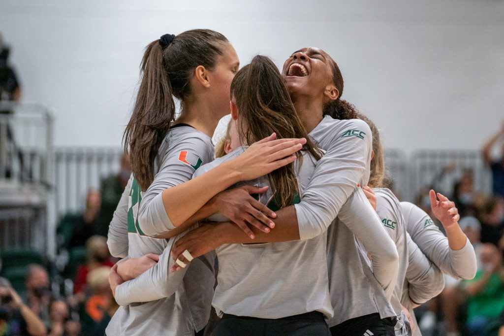 Junior middle blocker Janice Leao celebrates with teammates after Miami won the first set of their match versus the University of North Carolina in the Knight Sports Complex on Oct. 1, 2021.