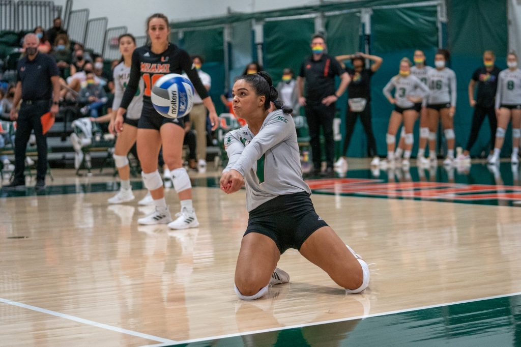 Freshman defensive specialist Yaidaliz Rosado bumps the ball during the fourth set of Miami's match versus the University of North Carolina in the Knight Sports Complex on Oct. 1, 2021.
