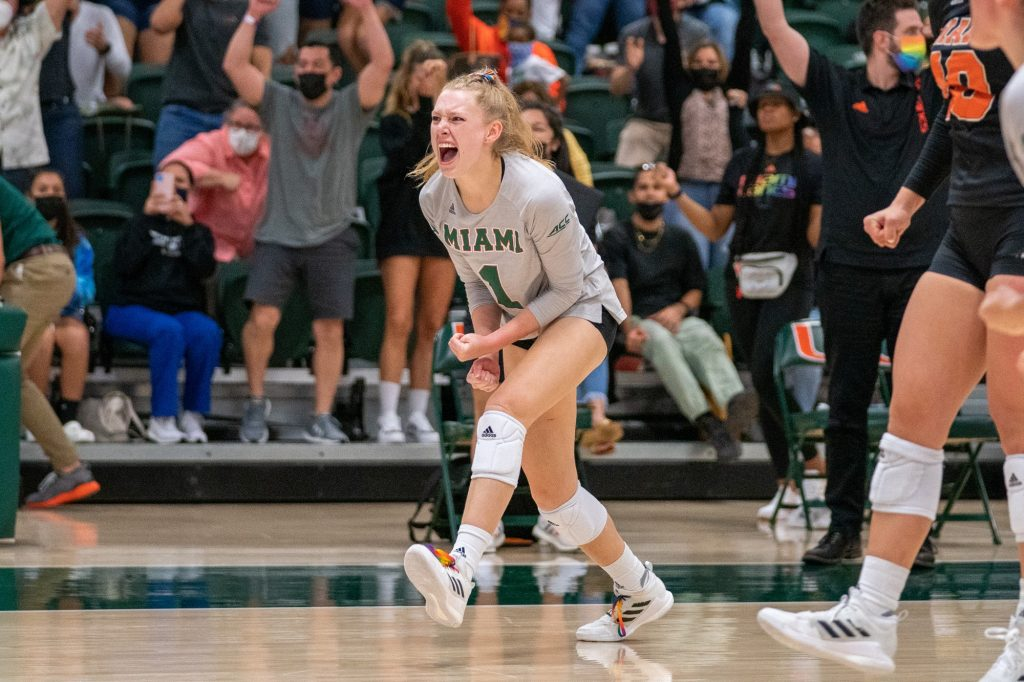 Junior setter Savannah Vach celebrates after Miami won the final set, and their match versus the University of North Carolina in the Knight Sports Complex on Oct. 1, 2021.