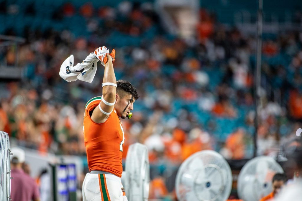 Freshman wide receiver Xavier Restrepo waves his towel around right before kickoff against Virginia on Thursday Sept. 30 at Hard Rock Stadium.