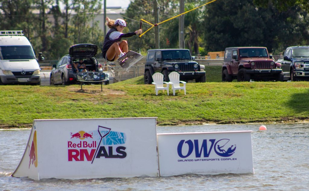 Freshman Daniela Abuchaibe performing a big tail grab at the Redbull Rivals Wakeboarding tournament at Orlando Watersports Complex. Abuchaibe later qualified for the final round of the Big Air Kicker competition.