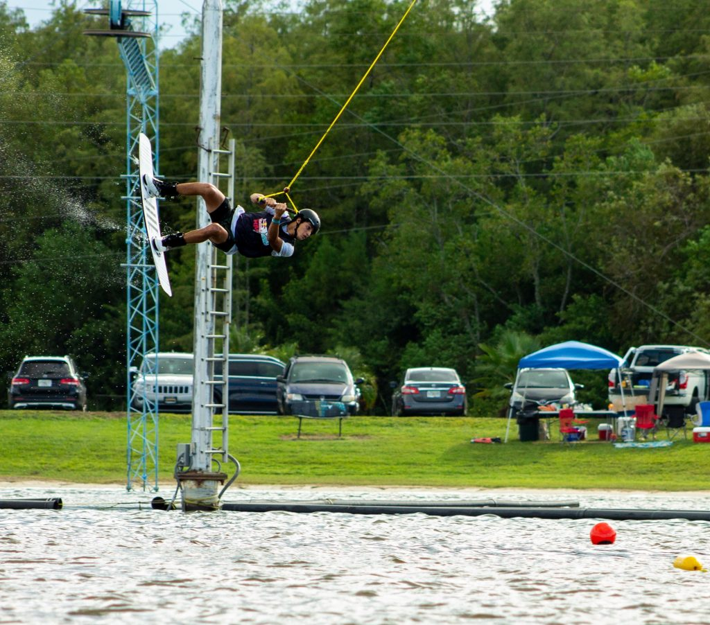 Freshman Diego Paredes mid-air while competing in the Redbull Rivals Wakeboarding competition at Orlando Watersports Complex. Paredes is individually competing in the One Fall Competition.
