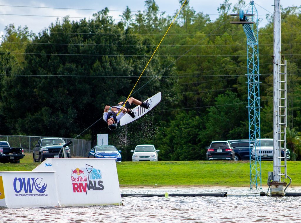 Freshman Diego Paredes performing a toe side roll to revert his body weight in the Big Air Kicker Competition at Orlando Watersports Complex. Paredes competed against four different universities at the RedBull-sponsored competition.
