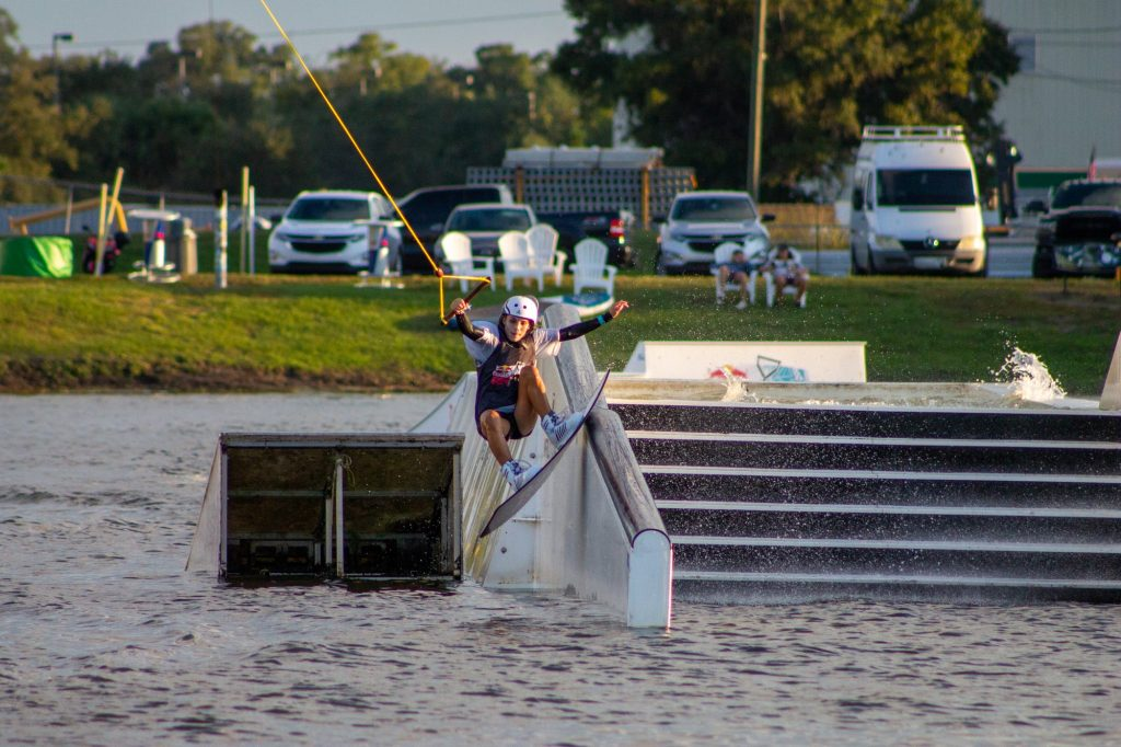 Freshman Daniela Abuchaibe attempts a boardslide down the railing at the Redbull Rivals Wakeboarding competition in Orlando, Fl. Abuchaibe competed in both the Big Air Kicker Competition and the Rail Jam Competition.