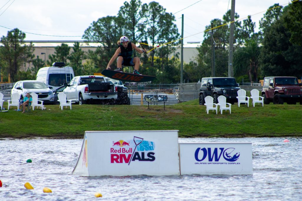 Senior president Tyler Gallant completing a 360-degree frontside nose grab during a practice session at Orlando Watersports Complex. Gallant later competed in the most competitive heats for each competition against four other universities at the Redbull-sponsored event.