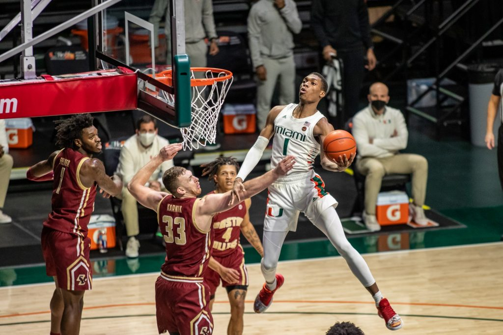 Sophomore Anthony Walker attempts a layup in Miami's win over Boston College on March 5, 2021 at the Watsco Center in Coral Gables.