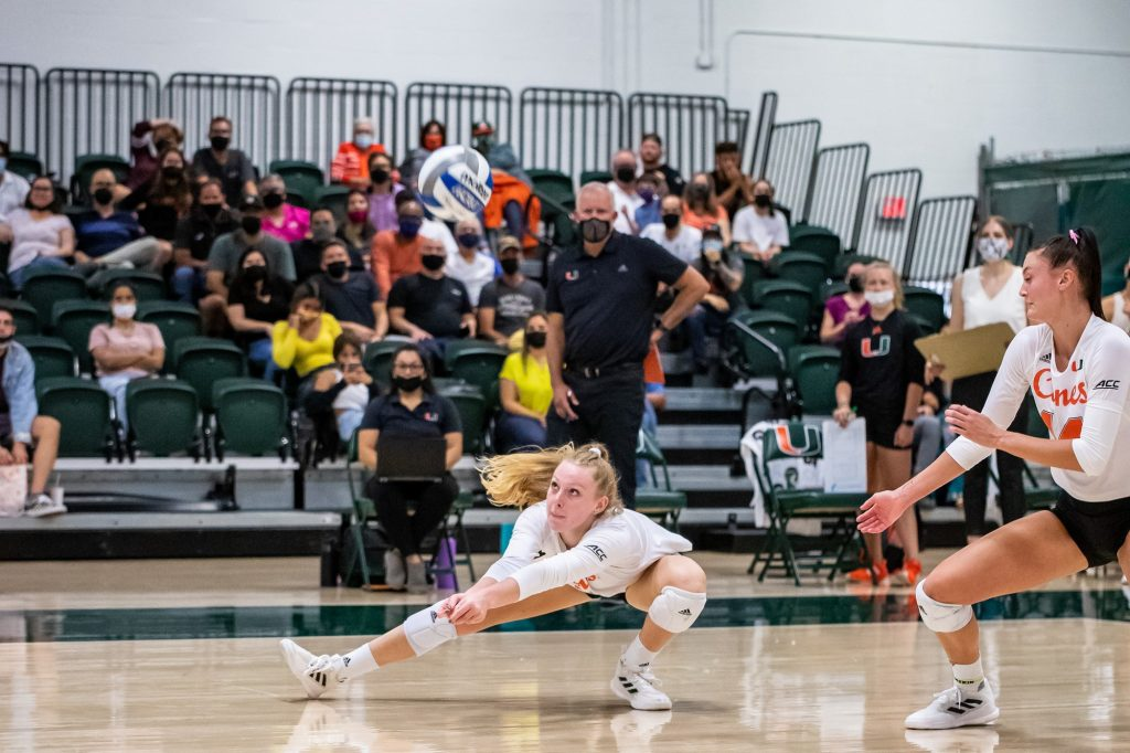 Junior setter Savannah Vach dives to save a point during Miami's win over FSU on Wednesday Oct. 6 at the Knight Complex in Coral Gables.