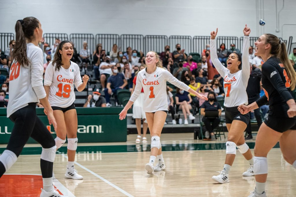 Miami players celebrate after securing a point during the fourth set in Miami's 3-1 victory over Florida State on Wednesday, Oct. 6 at the Knight Complex in Coral Gables Florida