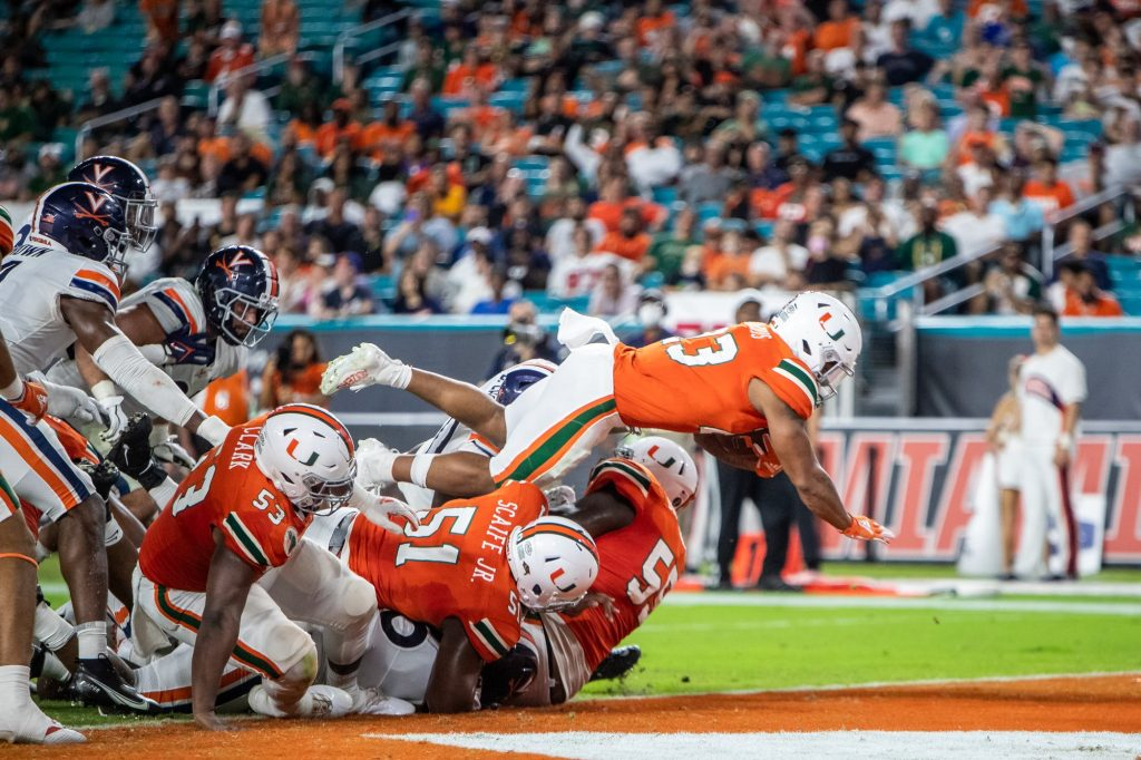 Running back Cam'Ron Harris leaps over the pile to score a touchdown against Virginia on Sept. 30, 2021 at Hard Rock Stadium.