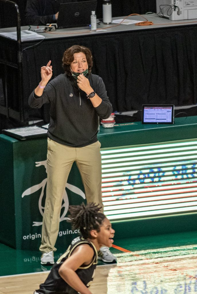 Head coach Katie Meyer yells at players as they move up the court in Miami's win over Wake Forest on Feb. 25 2021 at the Watsco Center in Coral Gables.